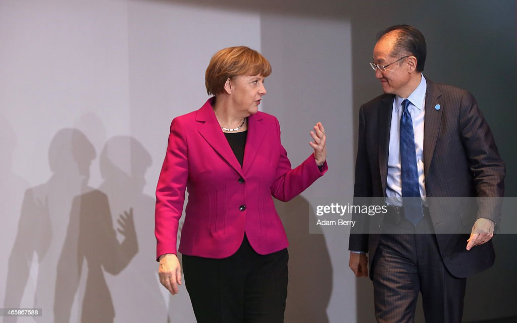 German Chancellor Angela Merkel (L) speaks to World Bank Group President <a gi-track='captionPersonalityLinkClicked' href=/galleries/search?phrase=Jim+Yong+Kim&family=editorial&specificpeople=2302483 ng-click='$event.stopPropagation()'>Jim Yong Kim</a> as they arrive for a meeting at the German federal Chancellery on March 11, 2015 in Berlin, Germany. Heads of the world's leading economic and financial organizations are meeting with the German chancellor to discuss several current issues including the crisis in Ukraine, the impending threat of financial meltdown in Greece and developments in the other eurozone economies, as Germany chairs the Group of Seven leading industrial nations this year.