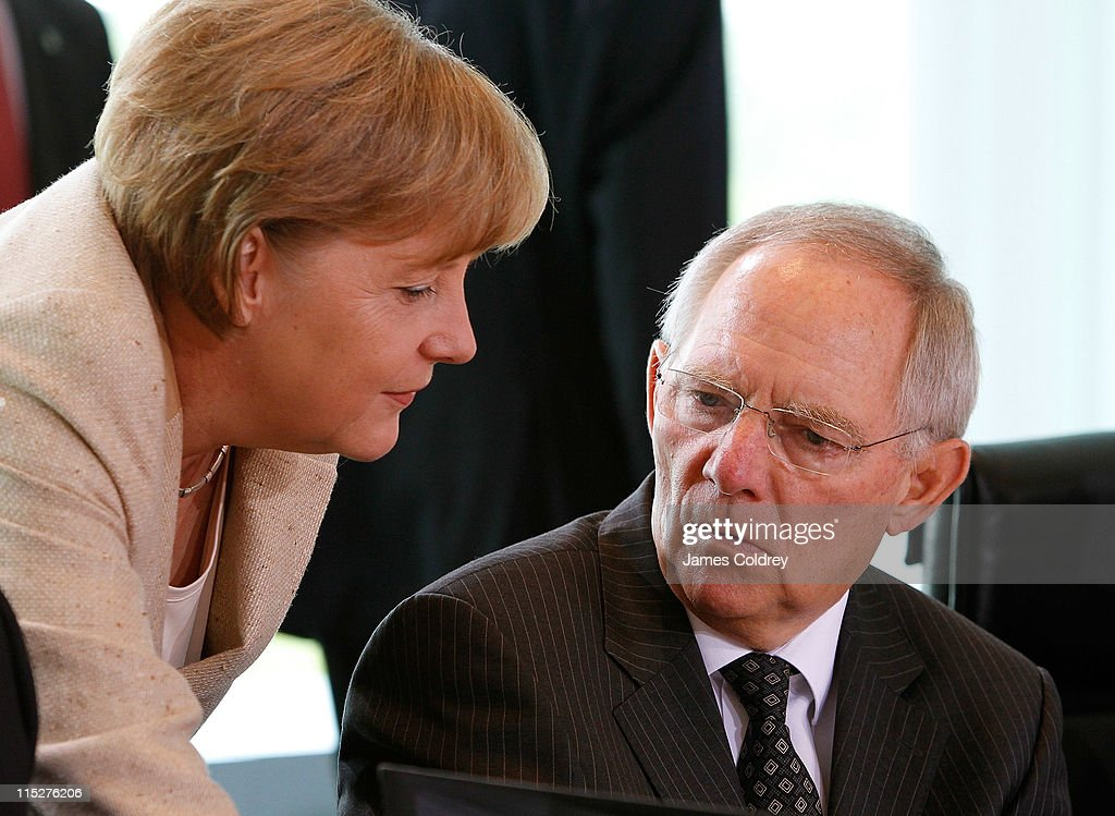 German Chancellor <a gi-track='captionPersonalityLinkClicked' href=/galleries/search?phrase=Angela+Merkel&family=editorial&specificpeople=202161 ng-click='$event.stopPropagation()'>Angela Merkel</a> speaks with Finance Minister Wolfgang Schaeuble upon her arrival at the weekly German government cabinet meeting on June 6, 2011 in Berlin, Germany. Merkel and her cabinet ministers were expected to approve a new law that will phase out nuclear energy in Germany by forcing utilities to shut down their 17 nuclear power reactors by 2022.