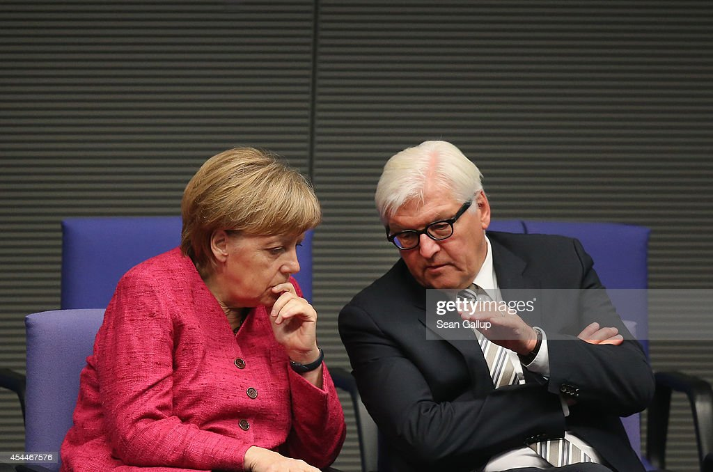 German Chancellor <a gi-track='captionPersonalityLinkClicked' href=/galleries/search?phrase=Angela+Merkel&family=editorial&specificpeople=202161 ng-click='$event.stopPropagation()'>Angela Merkel</a> speaks with Foreign Minister <a gi-track='captionPersonalityLinkClicked' href=/galleries/search?phrase=Frank-Walter+Steinmeier&family=editorial&specificpeople=603500 ng-click='$event.stopPropagation()'>Frank-Walter Steinmeier</a> after she gave a government declaration to justify her government's decision to send arms to Iraqi Kurdish forces at the Bundestag on September 1, 2014 in Berlin, Germany. Germany will furnish Kurdish peshmerga troops with anti-tank weapons, machine guns, hand grenades, assault rifles and other military hardware with a total value of EUR 70 million to help them push back ISIS separatists. The German government does not need Bundestag support to send the weapons.