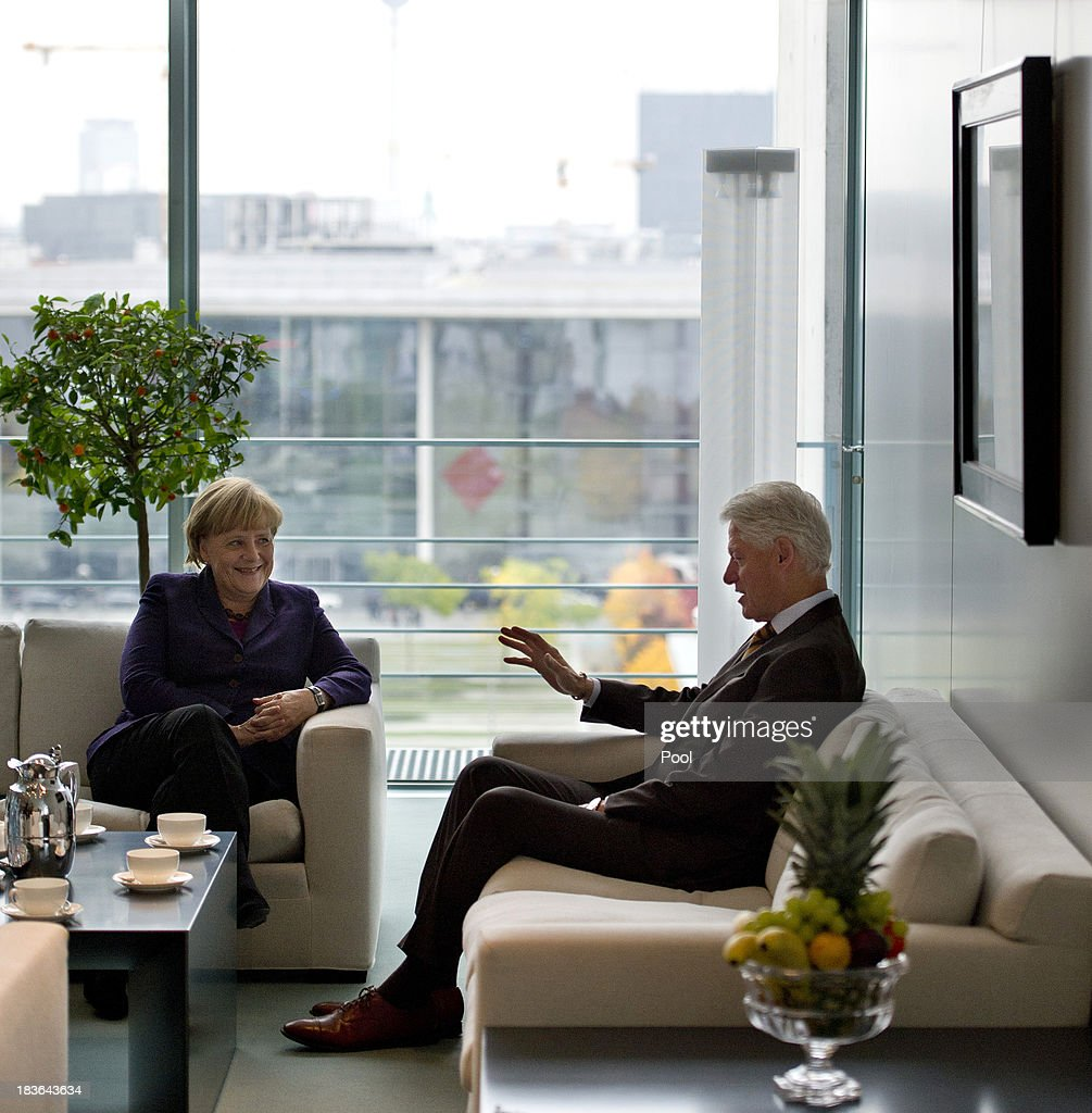 German Chancellor <a gi-track='captionPersonalityLinkClicked' href=/galleries/search?phrase=Angela+Merkel&family=editorial&specificpeople=202161 ng-click='$event.stopPropagation()'>Angela Merkel</a> (L) speaks with former U.S. President <a gi-track='captionPersonalityLinkClicked' href=/galleries/search?phrase=Bill+Clinton&family=editorial&specificpeople=67203 ng-click='$event.stopPropagation()'>Bill Clinton</a> in her office at the Chancellery in Berlin on October 8, 2013. During his short visit to Berlin Clinton also gave a talk to the European Petrochemical Association.
