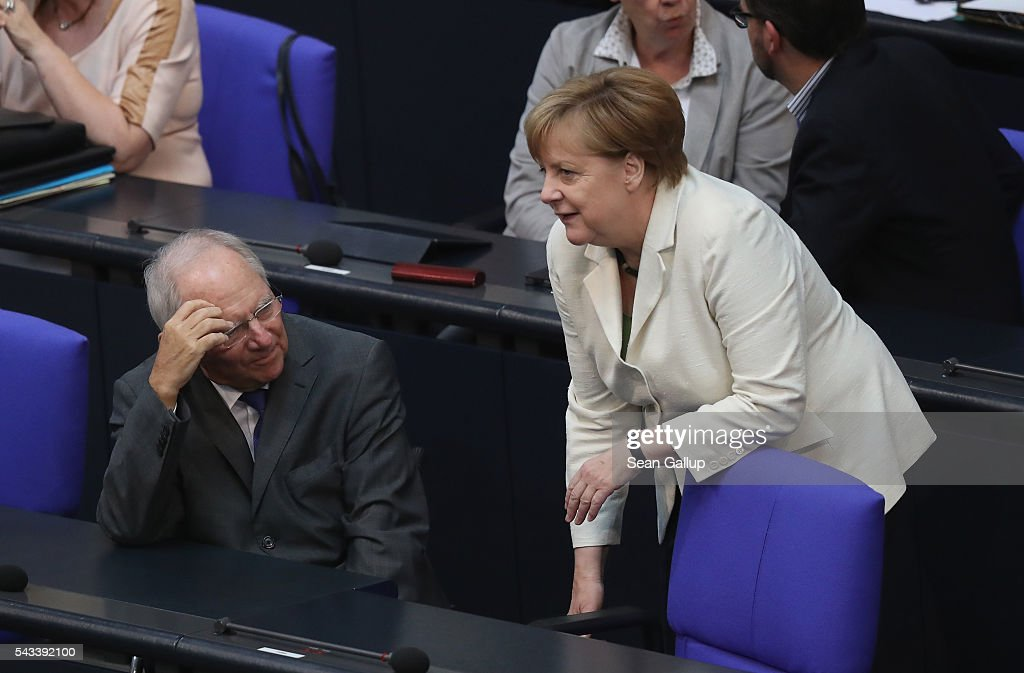 German Chancellor <a gi-track='captionPersonalityLinkClicked' href=/galleries/search?phrase=Angela+Merkel&family=editorial&specificpeople=202161 ng-click='$event.stopPropagation()'>Angela Merkel</a> speaks with German Finance Minister Wolfgang Schaeuble before she addressed the Bundestag with a government declaration on the recent Brexit vote on June 28, 2016 in Berlin, Germany. European leaders are scheduled to meet at a summit in Brussels later today to discuss the consequences of the British vote to leave the European Union. Merkel called the vote an unprecedented event in EU history but one the remaining 27 member states will weather.