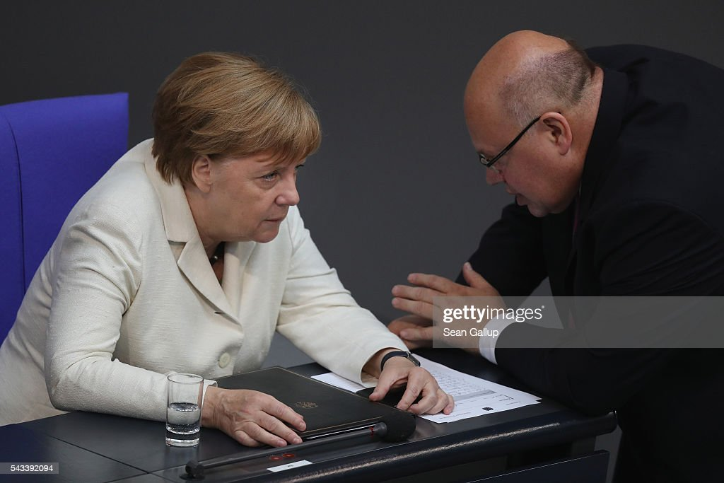German Chancellor <a gi-track='captionPersonalityLinkClicked' href=/galleries/search?phrase=Angela+Merkel&family=editorial&specificpeople=202161 ng-click='$event.stopPropagation()'>Angela Merkel</a> speaks with Minister of the Chancellery Peter Altmeier after she addressed the Bundestag with a government declaration on the recent Brexit vote on June 28, 2016 in Berlin, Germany. European leaders are scheduled to meet at a summit in Brussels later today to discuss the consequences of the British vote to leave the European Union. Merkel called the vote an unprecedented event in EU history but one the remaining 27 member states will weather.