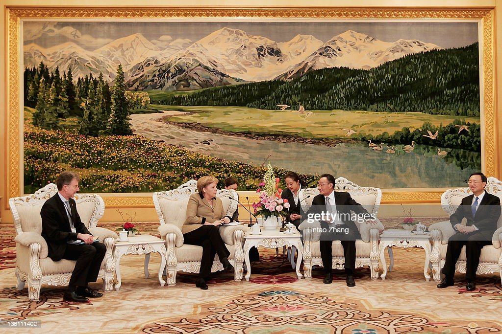 German Chancellor Angela Merkel speaks with NPC Chairman Wu Bangguo during a meeting at the Great Hall of the People on February 3 2012 in Beijing...