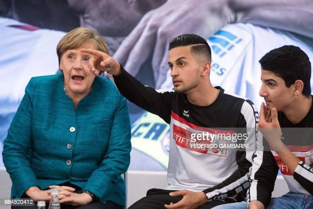 German Chancellor Angela Merkel speaks with participants of the foundation for refugees 'Wir Zusammen' in cooperation with the German First division...