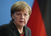 German Chancellor Angela Merkel speaks with Portuguese Prime Minister Pedro Passos Coelho to the media following bilateral talks at the Chancellery...