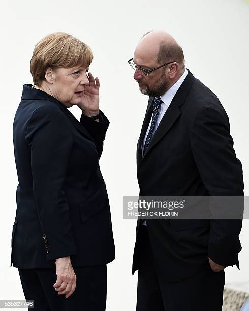 German Chancellor Angela Merkel speaks with President of European Parliament Martin Schulz during a remembrance ceremony to mark the centenary of the...