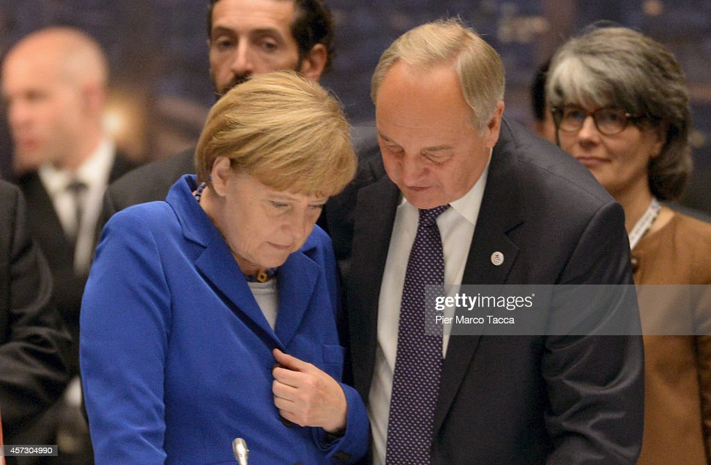 German Chancellor <a gi-track='captionPersonalityLinkClicked' href=/galleries/search?phrase=Angela+Merkel&family=editorial&specificpeople=202161 ng-click='$event.stopPropagation()'>Angela Merkel</a> speaks with Prime Minister of Latvia Andris Berzins during the 10 ASEM Summit with 50 Heads Of State From Europe And Asia on October 16, 2014 in Milan, Italy.The Asia-Europe Meeting (ASEM) was initiated in 1996 when the ASEM leaders met in Bangkok, Thailand. ASEM is an informal trans-regional platform for dialogue and cooperation between Asia and Europe