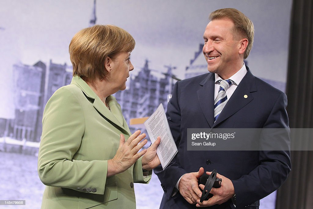 German Chancellor <a gi-track='captionPersonalityLinkClicked' href=/galleries/search?phrase=Angela+Merkel&family=editorial&specificpeople=202161 ng-click='$event.stopPropagation()'>Angela Merkel</a> speaks with Russian First Deputy Prime Minister Igor Shuvalov at the conclusion of the 2012 Council of Baltic Sea States Summit at the Ozeaneum maritime museum on May 30, 2012 in Stralsund, Germany. Leaders of the eleven member states as well as representatives of the European Union are meeting to discuss matters related to energy, the environment and economic development during the two-day summit.