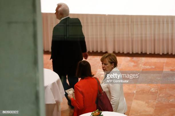 German Chancellor Angela Merkel speaks with the coleader of the Germany Greens Party Katrin GoeringEckardt as members of the delegations of the...