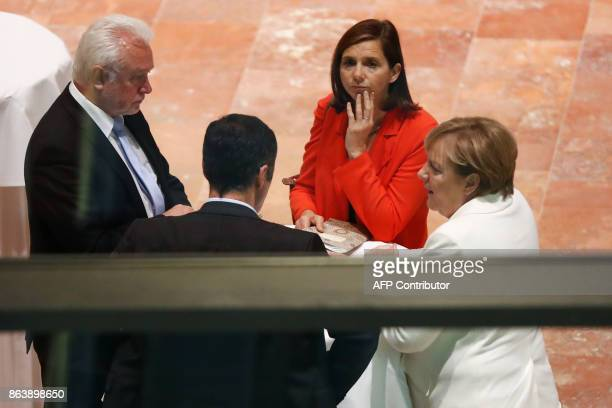 German Chancellor Angela Merkel speaks with the coleaders of the Germany Greens Party Cem Ozdemir and Party Katrin GoeringEckardt and Wolfgang...