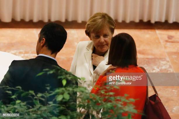 German Chancellor Angela Merkel speaks with the coleaders of the Germany Greens Party Cem Ozdemir and Katrin GoeringEckardt after members of the...