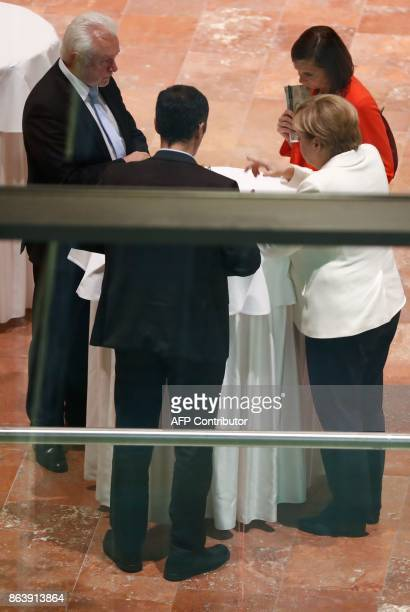 German Chancellor Angela Merkel speaks with the coleaders of the Germany Greens Party Cem Ozdemir and Katrin GoeringEckardt and Wolfgang Kubicki...
