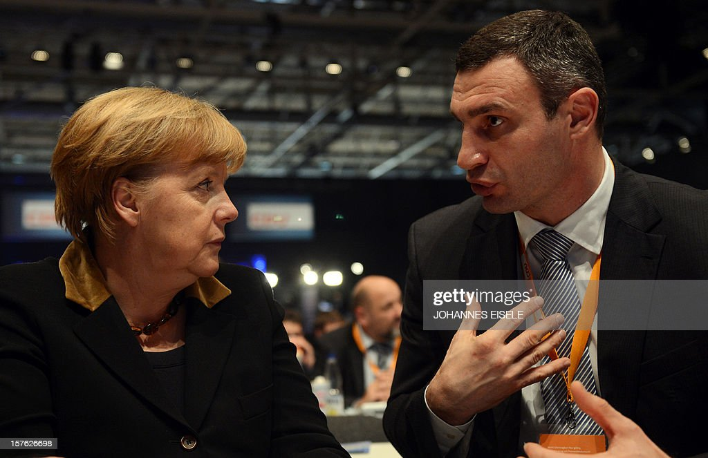 German Chancellor Angela Merkel speaks with Ukrainian box champion and member of Ukrainian Parliament Vitali Klitschko during a congress of Germany's ruling conservative Christian Democratic Union (CDU) party on December 4, 2012 in Hanover, central Germany. German Chancellor Angela Merkel was re-elected head of her conservative Christian Democrats (CDU) by more than 97 percent of delegates' votes at a two-day party congress. It was Merkel's best result since she took over as chairman of the CDU in 2000 and comes as she gears up for fighting for a third term at the helm of Europe's top economy in elections expected in September 2013.