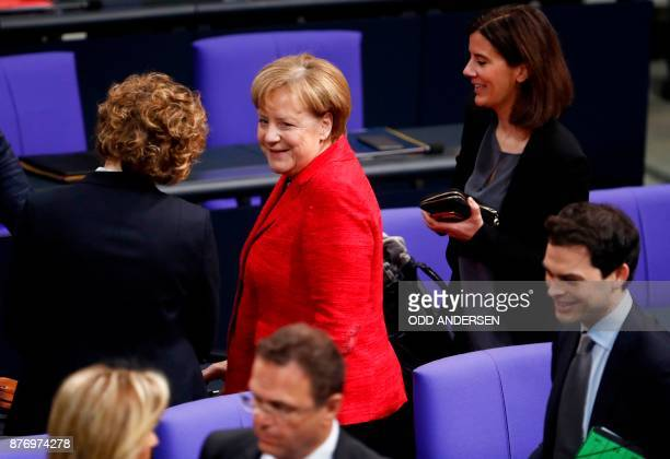 German Chancellor Angela Merkel stands between the SecretaryGeneral of the Free Democratic Party Nicola Beer and the vicechairman of the Free...