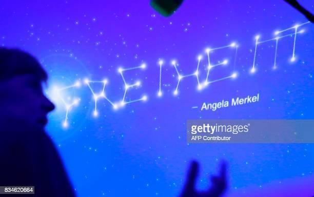 German Chancellor Angela Merkel stands in front of a wall with stars reading 'Liberty' during the opening ceremony of the CDU election campaign...