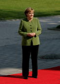 German Chancellor Angela Merkel stands on the red carpet to welcome the leaders of G8 nations for the first day of talks at the G8 summit June 7 2007...