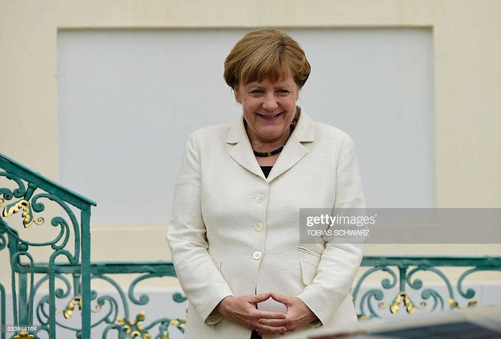 German Chancellor Angela Merkel stands outside Meseberg Palace on May 24, 2016 outside berlin. / AFP / TOBIAS