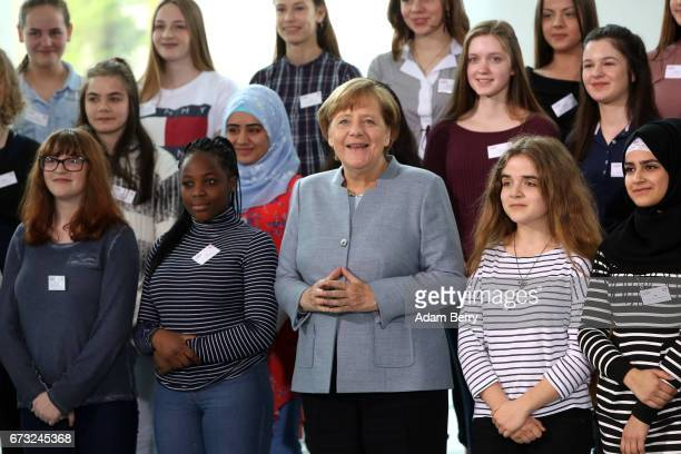 German Chancellor Angela Merkel stands with participants of Girls' Day on April 26 2017 in Berlin Germany The event is meant to encourage young women...