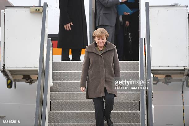 German Chancellor Angela Merkel steps off her plane upon arrival at Arlanda Airport outside Stockholm Sweden on January 31 2017 Merkel is on a oneday...