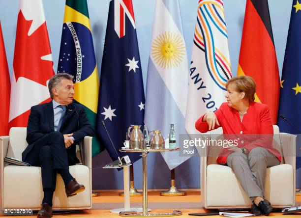 German Chancellor Angela Merkel talks to Mauricio Macri of Argentina during the G20 leaders retreat as part of the G20 summit on July 7 2017 in...