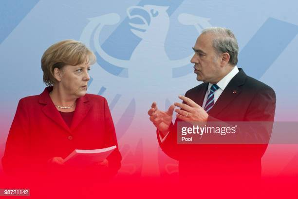 German Chancellor Angela Merkel talks to OECD SecretaryGeneral Jose Angel Gurria during the handover of the OECD Report at the Chancellery on April...