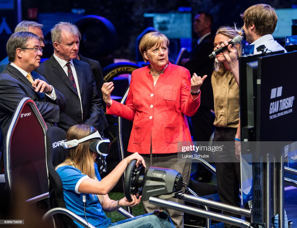 German Chancellor Angela Merkel talks to people of Sony while visiting the Gamescom 2017 video gaming trade fair on August 22, 2017 in Cologne, Germany. Merkel is currently running for a fourth term in federal elections scheduled for September 24. Gamescom is the world's second-largest games fair and attracts over 300,000 visitors. The 2017 fair will be open to the public from August 23-26.