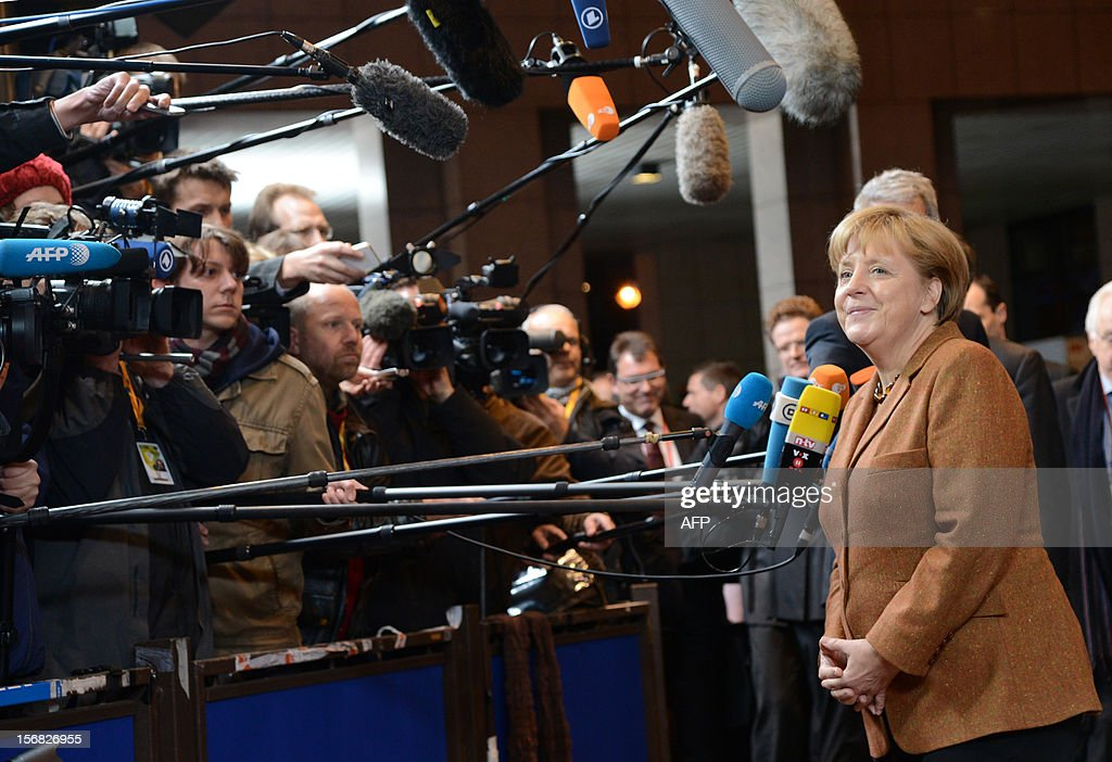 German Chancellor Angela Merkel talks to the press as she arrives at the EU Headquarters on November 22, 2012 in Brussels, to take part in a two-day European Union leaders summit called to agree a hotly-contested trillion-euro budget through 2020. European Union officials were scrambling to find an all but impossible compromise on the 2014-2020 budget that could successfully move richer nations looking for cutbacks closer to poorer ones who look to Brussels to prop up hard-hit industries and regions.