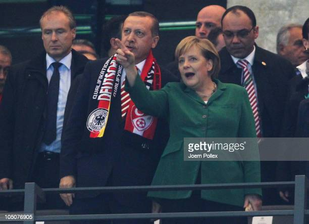 German Chancellor Angela Merkel talks to Turkish Prime Minister Tayyip Erdogan prior to the the EURO 2012 Group A qualifier match between Germany and...