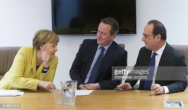 German Chancellor Angela Merkel talks with Britain Prime minister David Cameron and French President of Republic Francois Hollande during twodays...