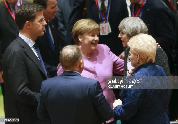 German chancellor Angela Merkel talks with British Prime Minister Theresa May Lithuania's President Dalia Grybauskaite and Dutch Prime Minister and...