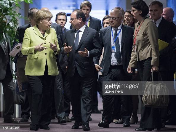 German Chancellor Angela Merkel talks with French President Francois Hollande after their bilateral meeting during a eurozone meeting on June 22 2015...