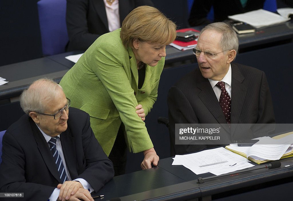 German Chancellor Angela Merkel talks with German Finance Minister Wolfgang Schaeuble (R) and German Economy Minister Rainer Bruederle during a debate at the Bundestag, the lower house of parliament, on May 21, 2010 in Berlin. The German parliament is set to unblock its share of a trillion-dollar rescue package for debt-stricken eurozone countries , after Chancellor Angela Merkel warned the euro was 'in danger'.