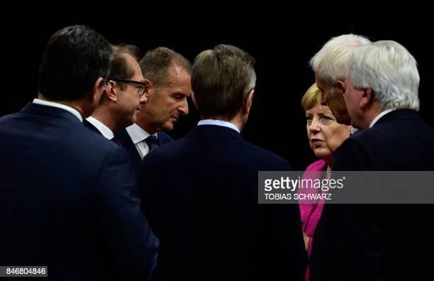 German Chancellor Angela Merkel talks with Hesse's State Premier Volker Bouffier Volkswagen chairman Matthias Mueller Volkswagen board member Herbert...