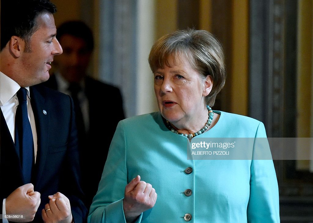 German Chancellor Angela Merkel (R) talks with Italian Prime Minister Matteo Renzi at Rome's Palazzo Chigi on May 5, 2016. EU president Donald Tusk travels to Rome Thursday with fellow EU institution leaders and German Chancellor Angela Merkel for two days of talks likely to focus on next steps in Europe's migrant crisis. Prime Minister Matteo Renzi, who fears Italy becoming the new migrant frontline after the closure of the Balkan route, will host the first day of talks, followed by Pope Francis on Friday. PIZZOLI