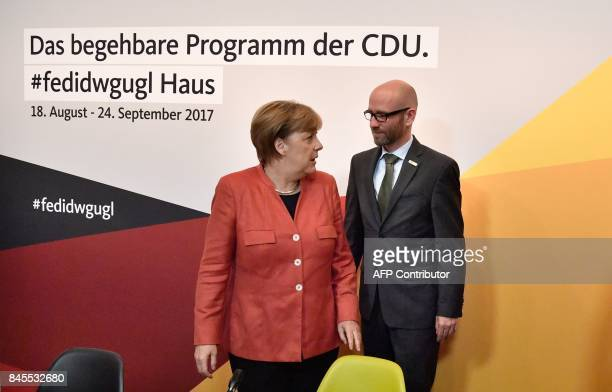 German Chancellor Angela Merkel talks with Peter Tauber secretary general of the conservative Christian Democratic Union party as they arrive for a...