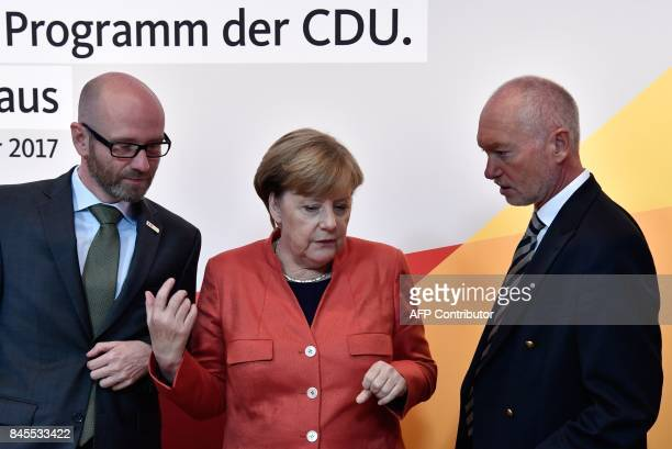 German Chancellor Angela Merkel talks with Peter Tauber secretary general of the conservative Christian Democratic Union party and CDU manager Klaus...