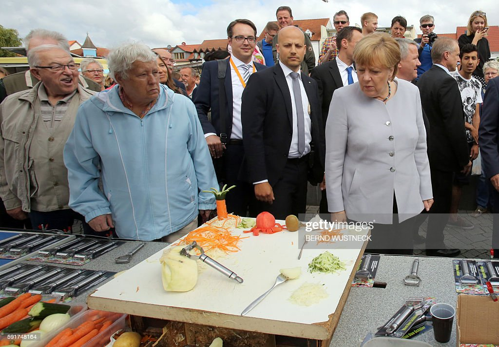 German Chancellor Angela Merkel talks with residents as she visits a street market in RibnitzDamgarten eastern Germany during her campaign trail...