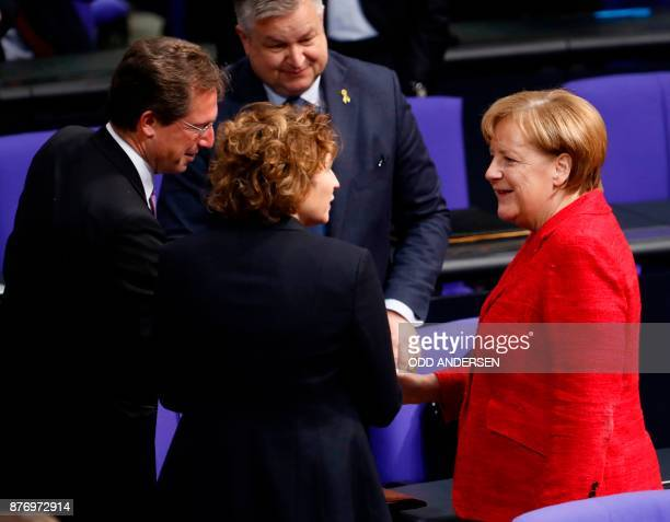 German Chancellor Angela Merkel talks with the SecretaryGeneral of the Free Democratic Party Nicola Beer at the opening of a session at the Bundestag...
