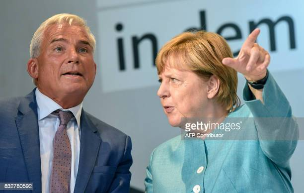 German Chancellor Angela Merkel talks with Thomas Strobl cochairman of the CDU during an election campaign rally of the Christian Democratic Union in...