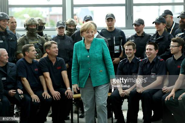 German Chancellor Angela Merkel thanks members of German law enforcement and emergency services at the conclusion of the G20 economic summit on July...