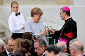 German Chancellor Angela Merkel toasts with Apostolic nuncio in Germany Archbishop Nikola Eterovic after he delivered his speech to foreign...