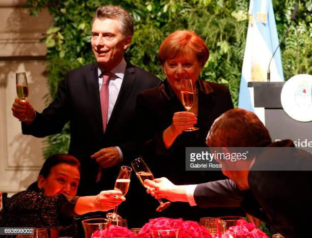 German Chancellor Angela Merkel toasts with President of Argentina Mauricio Macri the Vice President of Argentina Gabriela Michetti and Chief of the...
