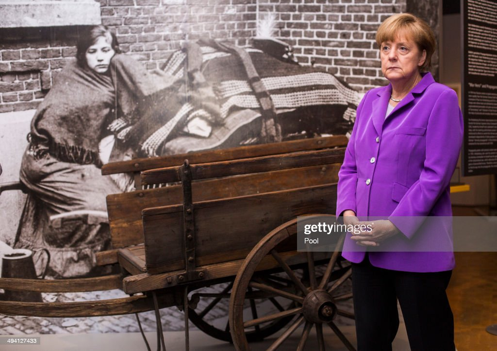 German Chancellor Angela Merkel tours the exhibition: 'The First World War, 1914-1918' ('Der Erster Weltkrieg, 1914-1918') on its official opening at the Deutsches Historisches Museum on May 28, 2014 in Berlin, Germany. The exhibition, which features over 250 exhibits organized along 14 thematic battlefield sites and other places from World War I, will be open to the public from May 29 thru November 30.