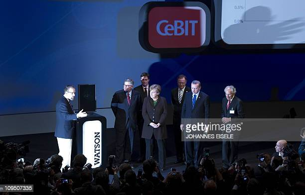 German Chancellor Angela Merkel Turkish Prime Minister Recep Tayyip Erdogan and IBM CEO Samuel Palmisano listen to explanations about the new...