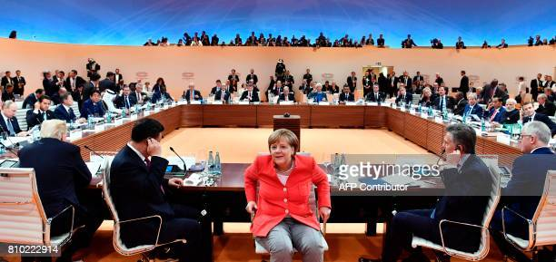 German Chancellor Angela Merkel turns around as US President Donald Trump China's President Xi Jinping Argentinia's President Mauricio Macri and...