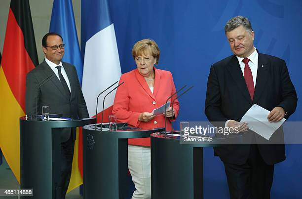 German Chancellor Angela Merkel Ukrainian President Petro Poroshenko and French President Francois Hollande arrive to speak to the media following...