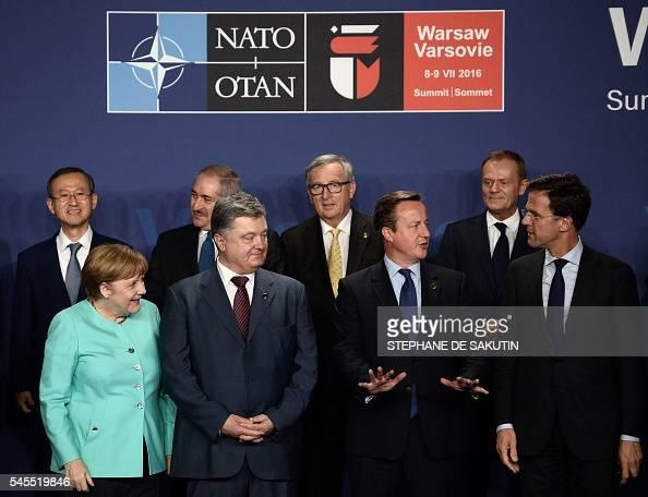 German Chancellor Angela Merkel Ukrainian President Petro Poroshenko British Prime Minister David Cameron and Dutch Prime Minister Mark Rutte pose...
