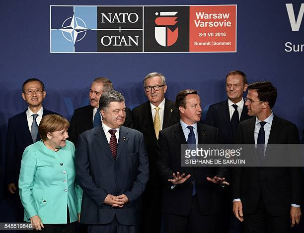 German Chancellor Angela Merkel Ukrainian President Petro Poroshenko British Prime Minister David Cameron and Dutch Prime Minister Mark Rutte pose...