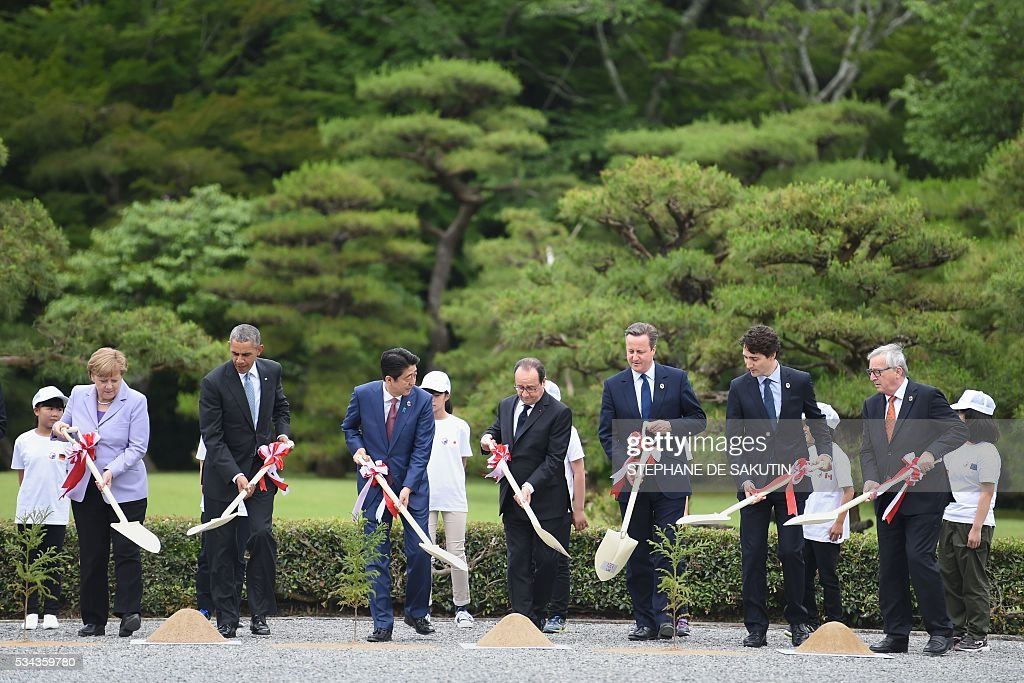 German Chancellor Angela Merkel, US President Barack Obama, Japan's Prime Minister Shinzo Abe, French President Francois Hollande, Britain's Prime Minister David Cameron, Canadian Prime Minister Justin Trudeau and European Commission President Jean-Claude Juncker take part in a planting ceremony on the grounds at Ise-Jingu Shrine in the city of Ise in Mie prefecture, on May 26, 2016 on the first day of the G7 leaders summit. World leaders kick off two days of G7 talks in Japan on May 26 with the creaky global economy, terrorism, refugees, China's controversial maritime claims, and a possible Brexit headlining their packed agenda. / AFP / STEPHANE