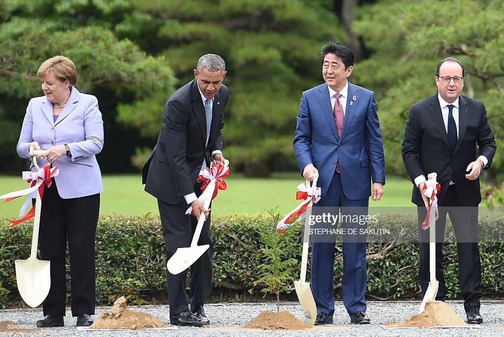 German Chancellor Angela Merkel, US President Barack Obama, Japan's Prime Minister Shinzo Abe and French President Francois Hollande take part in a tree-planting ceremony on the grounds at Ise-Jingu Shrine in the city of Ise in Mie prefecture, on May 26, 2016 on the first day of the G7 leaders summit. World leaders kicked off two days of G7 talks in Japan on May 26 with the creaky global economy, terrorism, refugees, China's controversial maritime claims, and a possible Brexit headlining their packed agenda. / AFP / STEPHANE